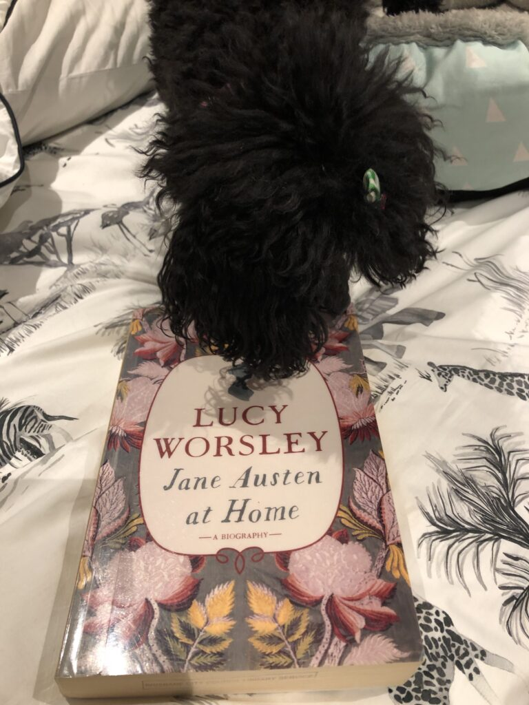 "My dog Rosie with the book ""Jane Austen at Home"" by Lucy Worsley"
